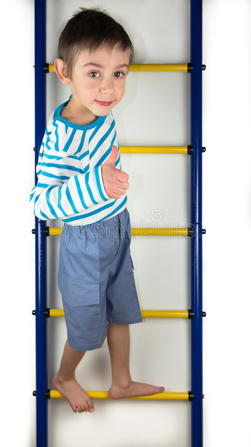 A child stands on a ladder royalty free stock photos