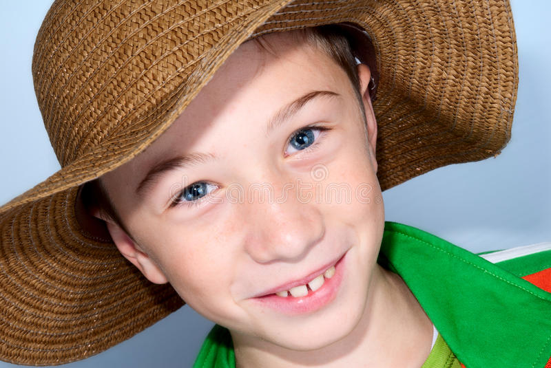 Child with starws hat royalty free stock image