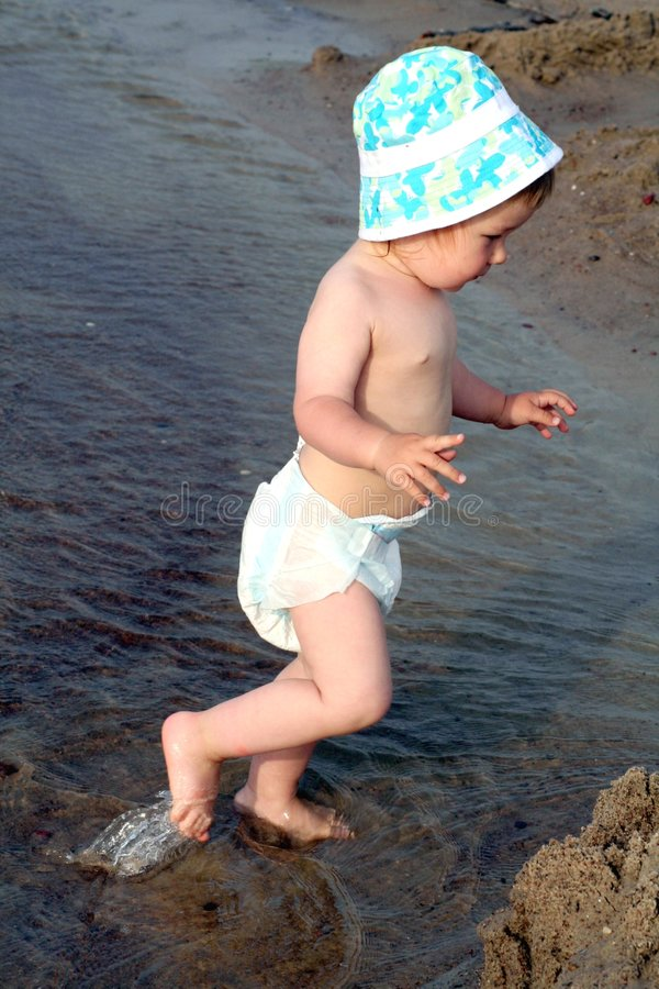 Child Steps Into The Sea Royalty Free Stock Image