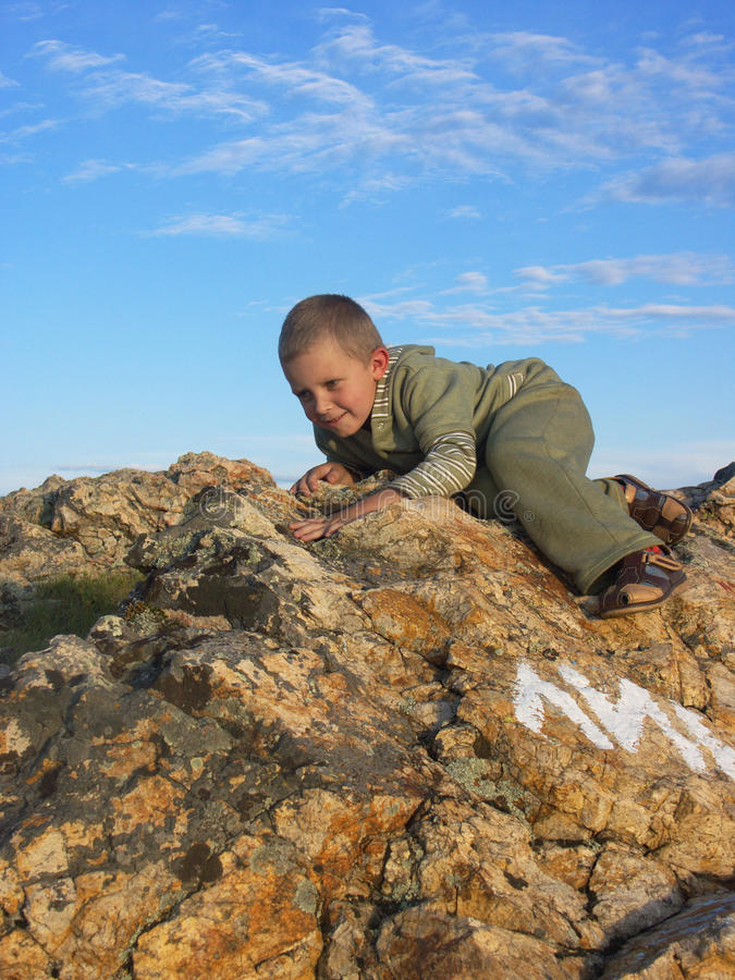 The child on a stone stock photo