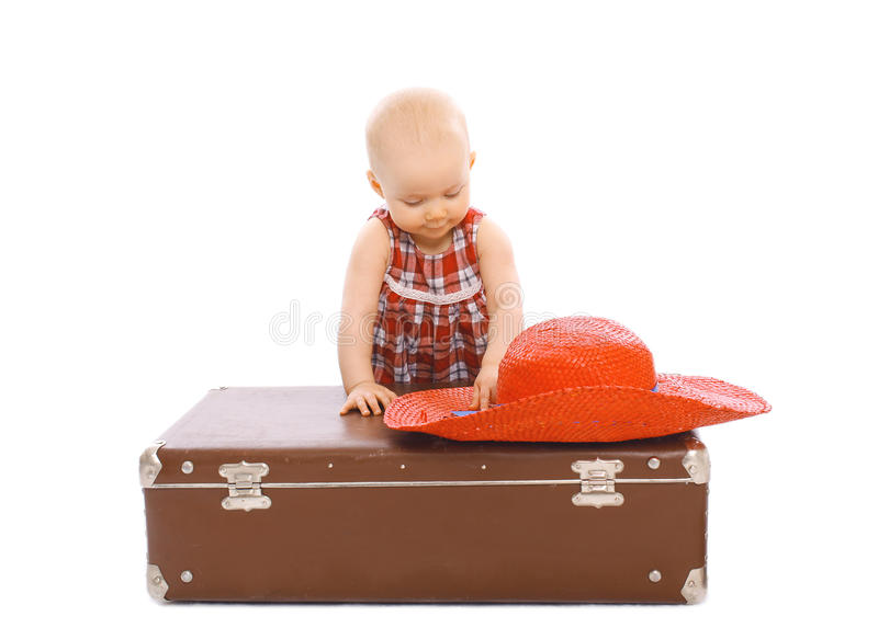 Child with straw summer hat and suitcase stock images