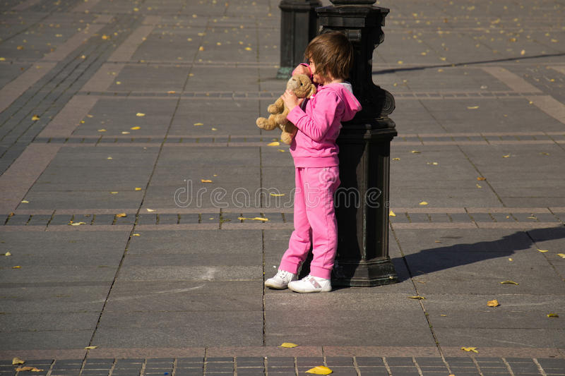 Child and street lamp post.  stock photos