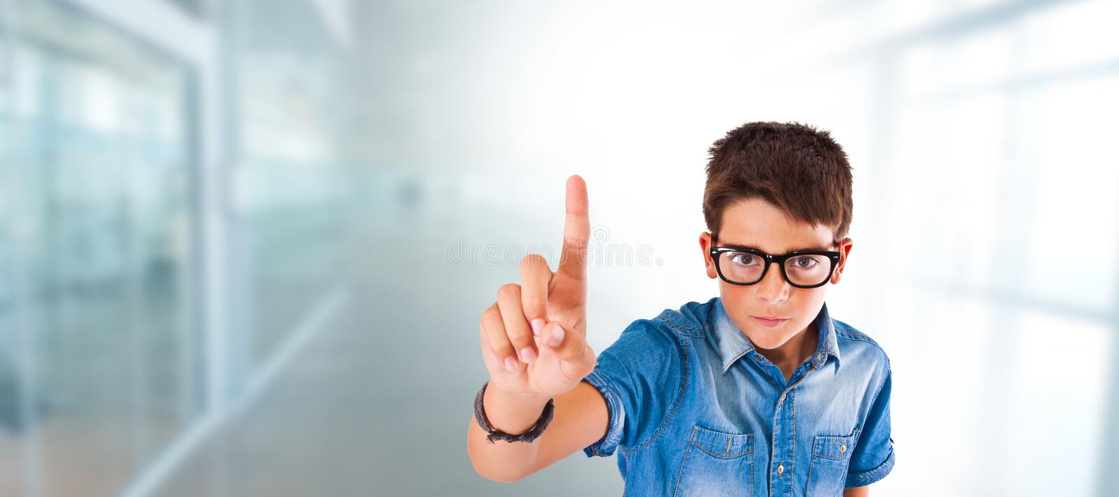 Child or student with glasses and hand raising finger stock image