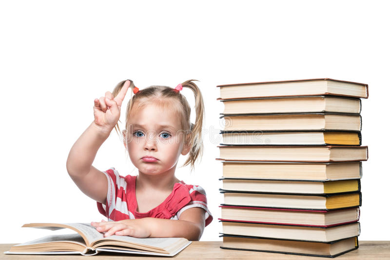 Child is studying the book stock photo