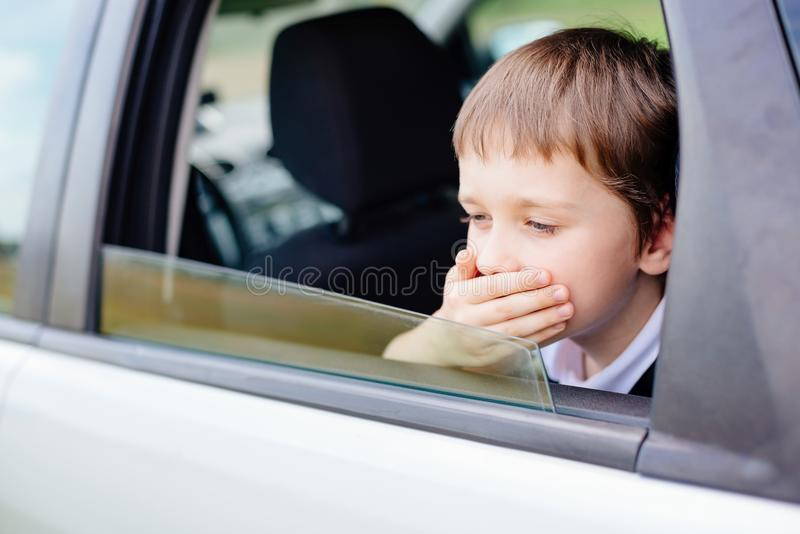 Child suffers from motion sickness in car royalty free stock photography
