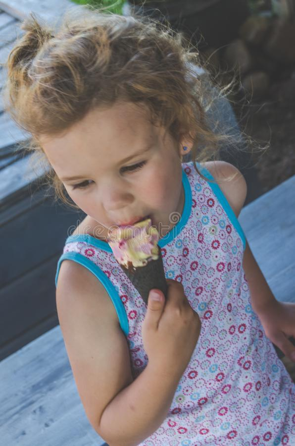 Child summer day eating ice cream royalty free stock photography