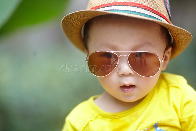 Child with sunglasses. Handsome baby boy with sunglasses royalty free stock photography