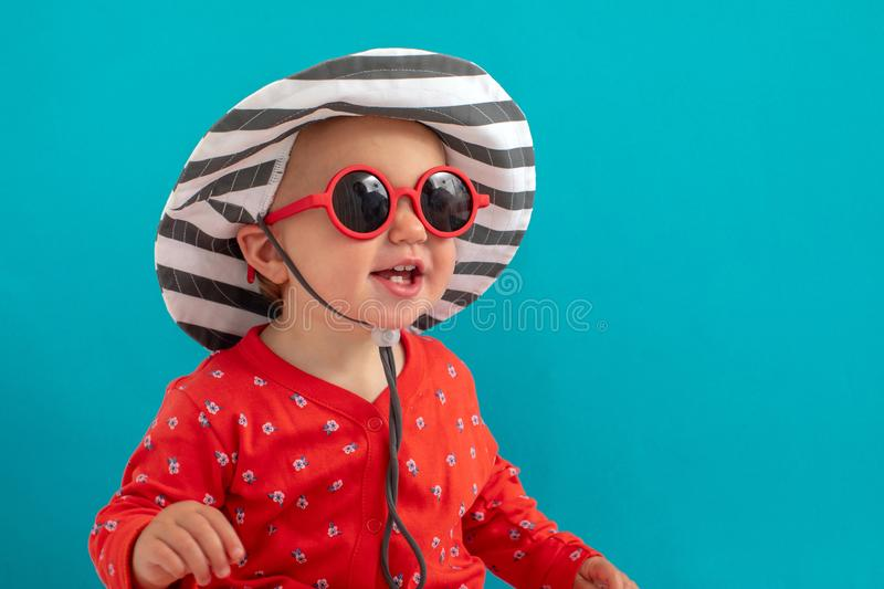 Child in sunglasses and hat stock photo
