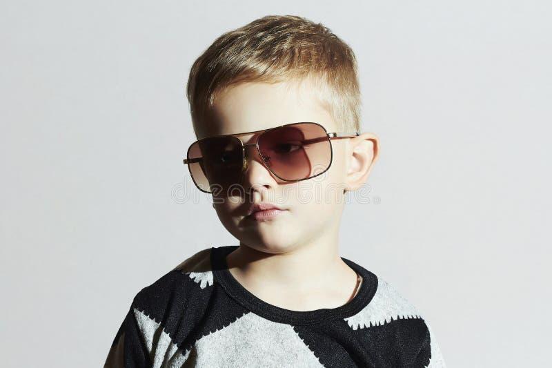 Child in sunglasses.sad Little boy.Kids fashion. Portrait of child in sunglasses.sad Little boy.Kids fashion royalty free stock photography