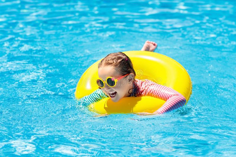 Child in swimming pool. Kids swim. Water play. royalty free stock photography