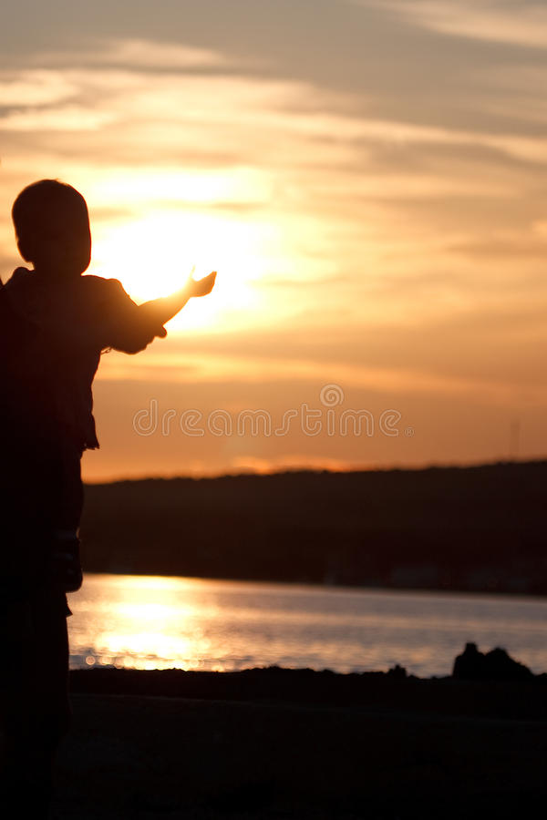Child in the sunset royalty free stock photo