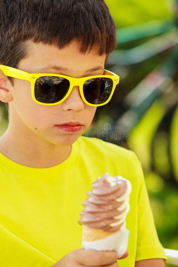 Child with sweet food outdoor stock photo