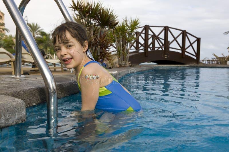 Child swimming. Fun in a swimming pool stock photo