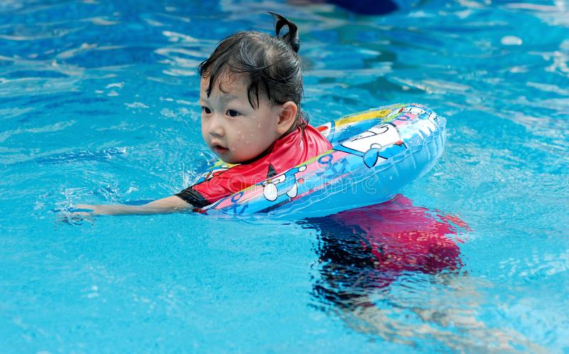 The child swimming stock images