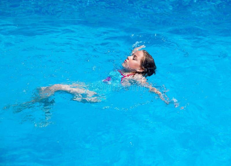 Child swimming backstroke royalty free stock image