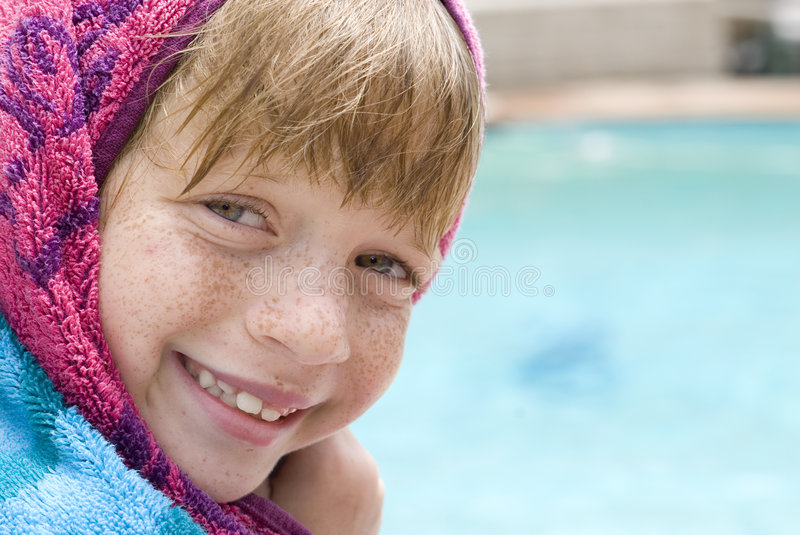 Child at the swimming pool stock images