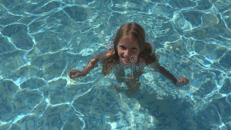 Child Swimming in Pool, Smiling Kid, Girl Portrait Enjoying Summer Vacation stock photography