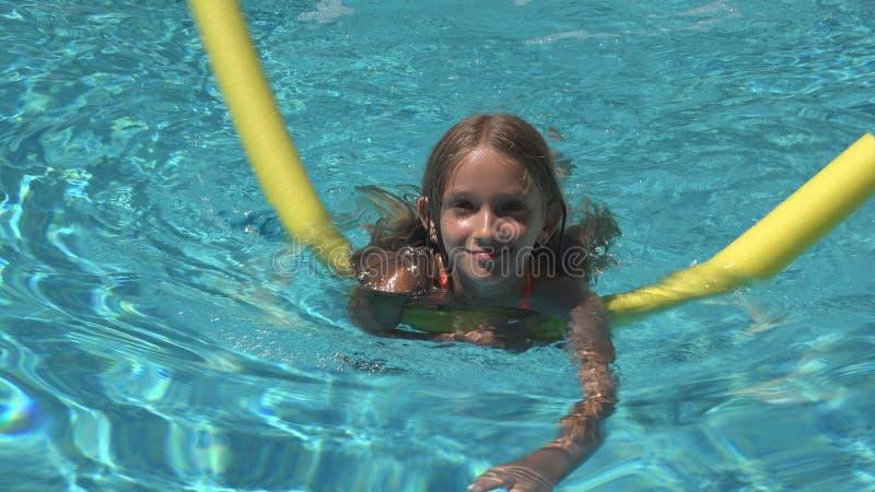 Child Swimming in Pool, Smiling Kid, Girl Portrait Enjoying Summer Vacation stock photo