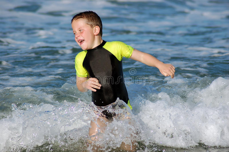 Child Swimming in the sea stock photo