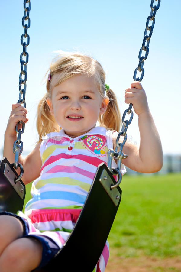Download Child on swing stock image. Image of swing, freedom, looking - 17117221