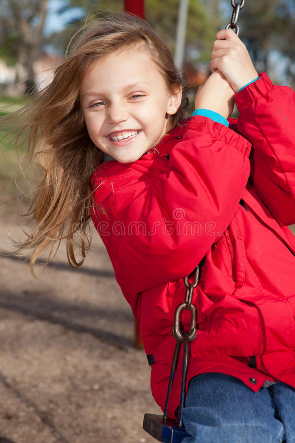 Download Child on a swing stock image. Image of green, park, face - 24582447