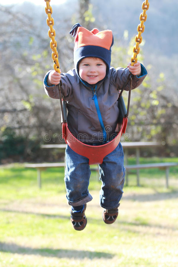 Download Child On Swing At A Playground Stock Photo - Image: 22984702