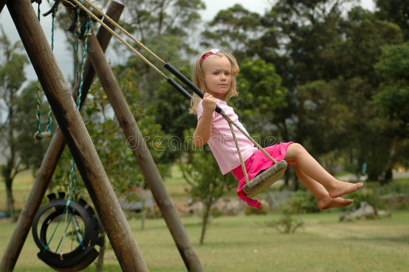 Child swinging stock image. Image of caucasian, girl ...