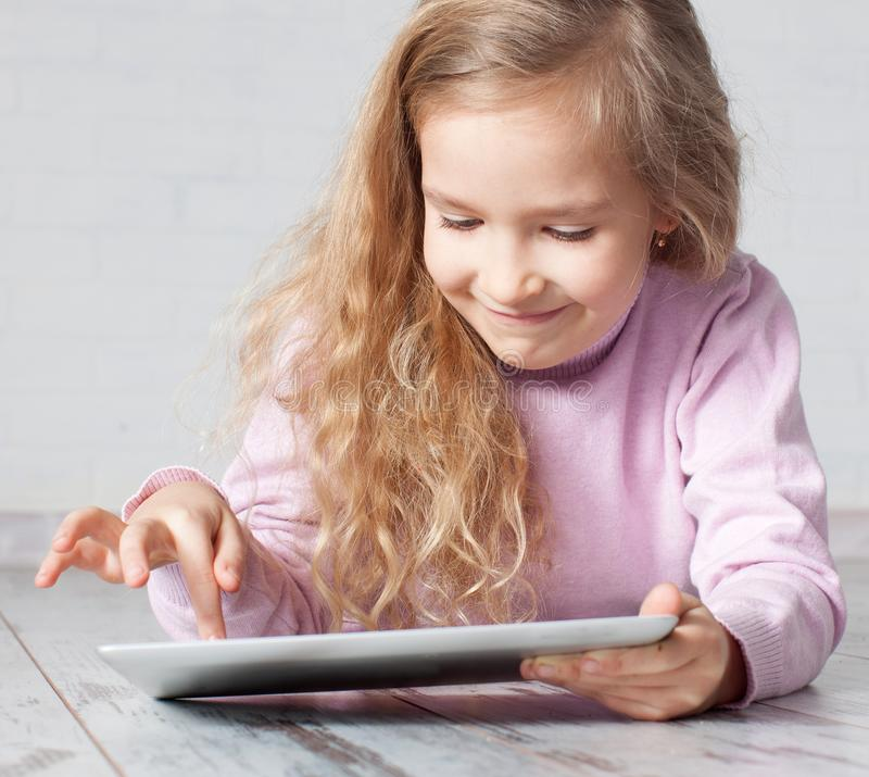 Child with tablet pc stock photography