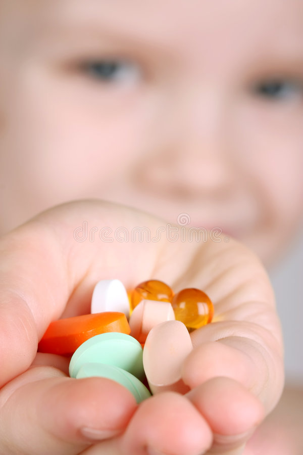 Child takes vitamins royalty free stock images