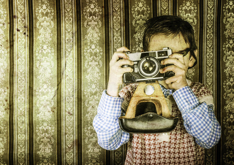 Child taking pictures with vintage camera stock images