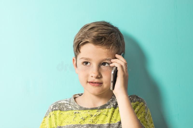 Child talking on a mobile phone stock photography