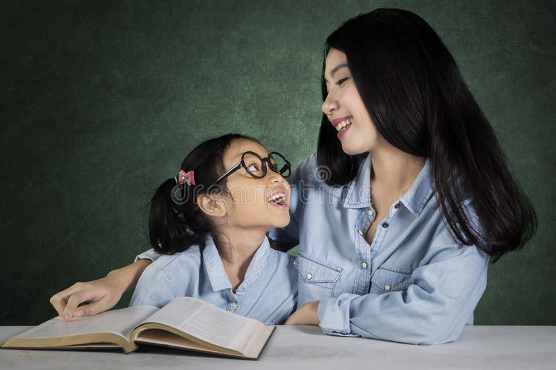 Child talking with teacher in class stock photos