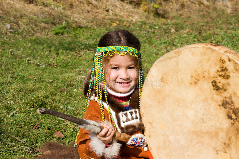 Child with tambourine. Portrait child chukchis clad in national gown with tambourine stock photos