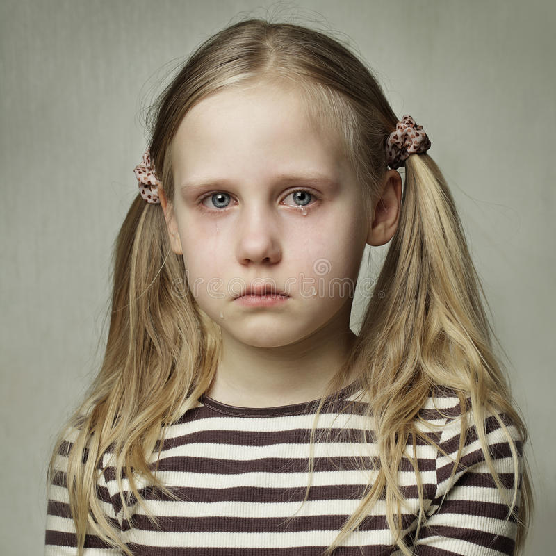 Child with tears - young girl crying royalty free stock images