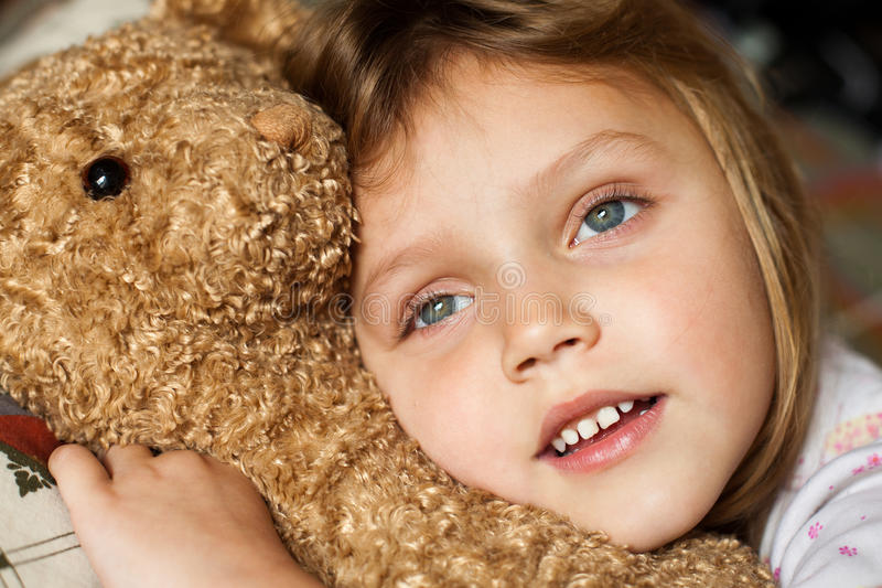 Download Child with teddy bear stock image. Image of gift, comforting - 21956973