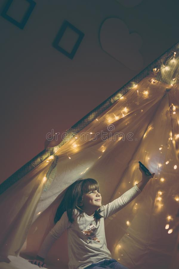 Child in a teepee stock photos