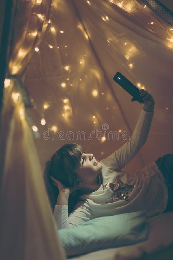 Child in a teepee royalty free stock photo