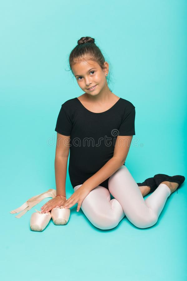 Child tender dancer look gorgeous fancy leotard. Dream every girl become famous gymnast. Kid sit hold pointe ballet. Shoes. Special shoes for ballet. Child stock images