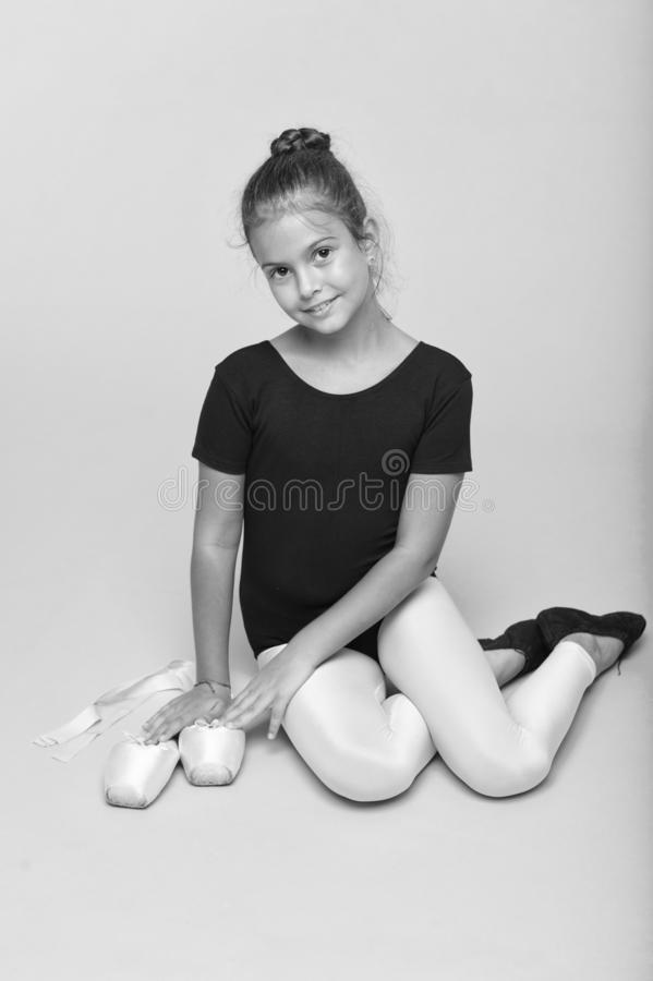 Child tender dancer look gorgeous fancy leotard. Dream every girl become famous gymnast. Kid sit hold pointe ballet. Shoes. Special shoes for ballet. Child stock photography