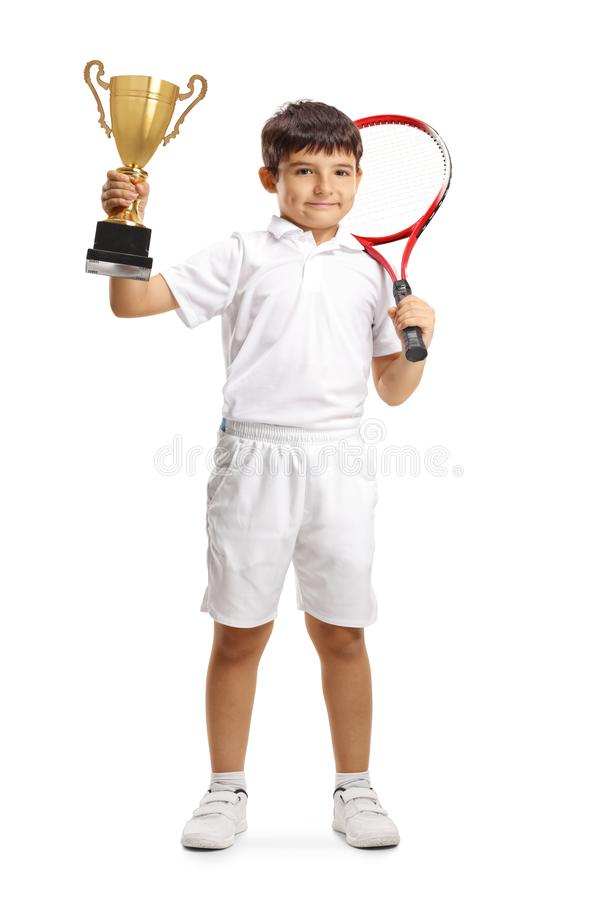 Child tennis player with a trophy cup stock photo