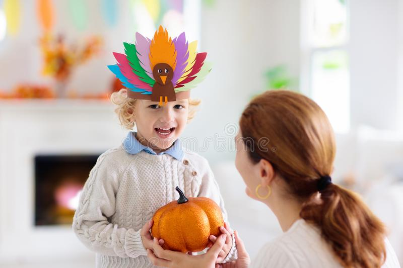 Child on Thanksgiving. Kid with autumn turkey hat royalty free stock photos
