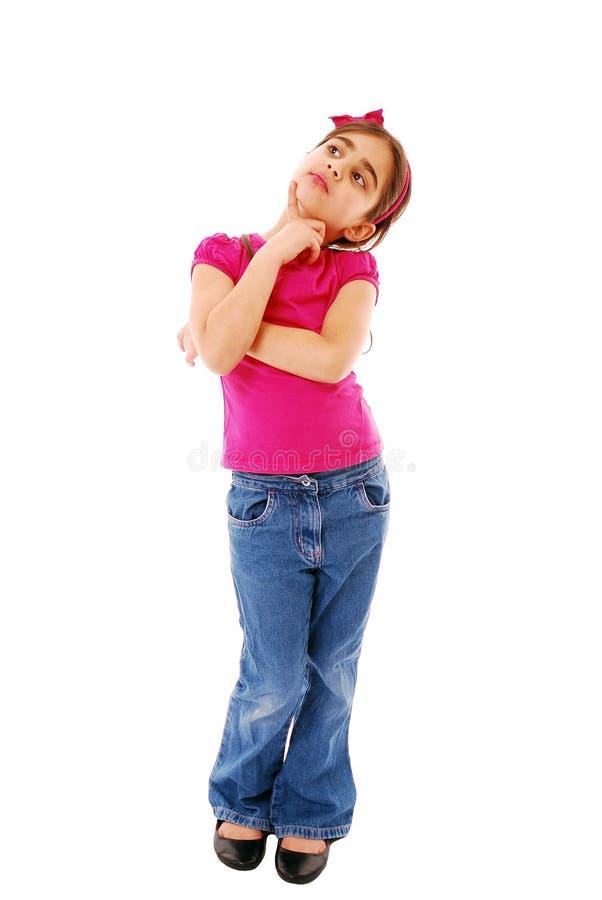Child thinking. Girl thinking looking up isolated on white royalty free stock images