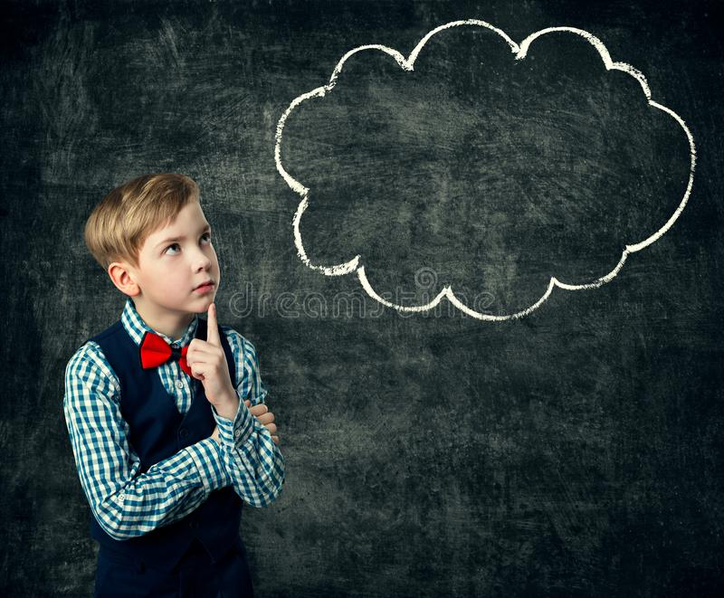 Child Thinking Bubble over Blackboard Background, School Boy. Student in Retro Uniform looking to Chalk Draw stock image