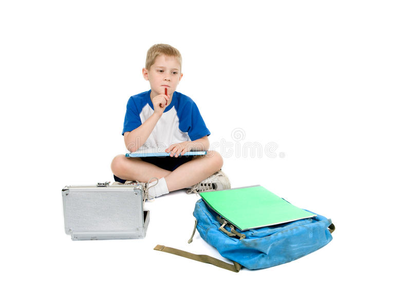 Child thinking about homework royalty free stock photos