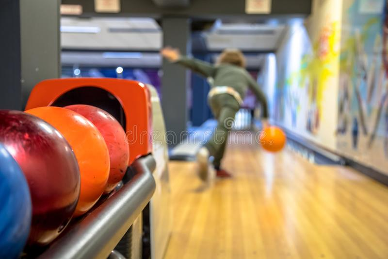 Child throwing bowling ball royalty free stock images