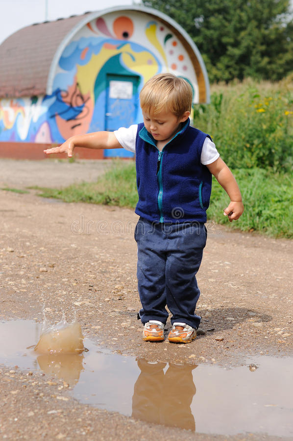 Download Child Throwing Small Stone To Pool Stock Image - Image: 20741651