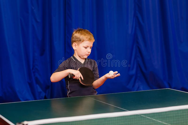 Child throws the ball in table tennis royalty free stock photography
