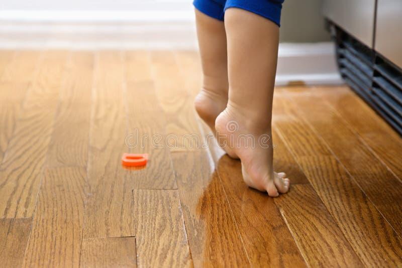 Child on tiptoe. stock photography