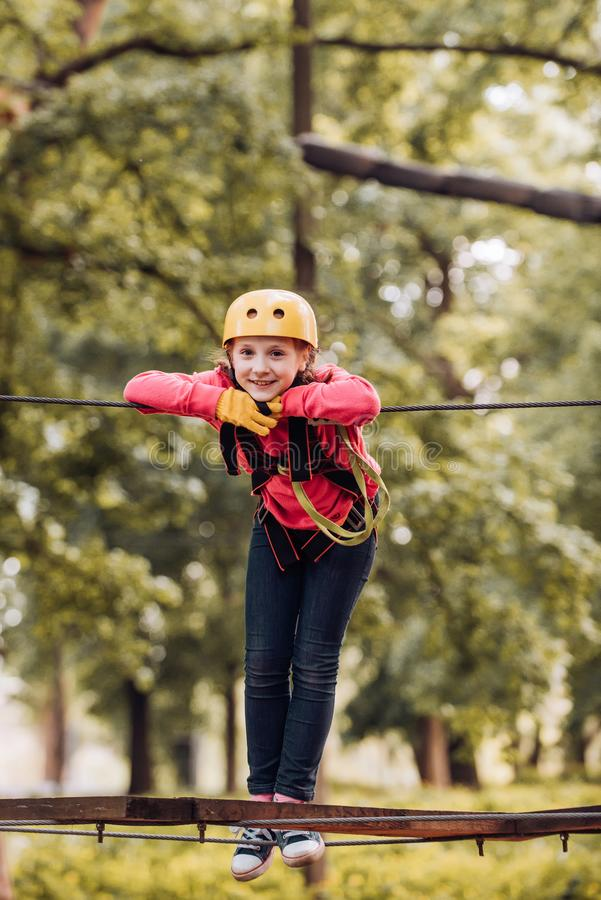 Child. Toddler age. Happy child in summer. Climber child. Adventure climbing high wire park. Every childhood matters stock photography