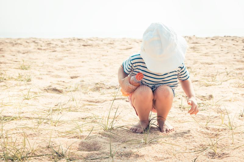 Child toddler playing beach summer holidays vacation childhood traveling lifestyle stock images